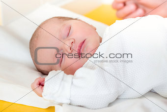sleeping newborn baby in the hospital