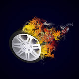 Car wheel in the colored smoke
