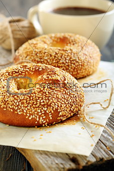 Breakfast. Sweet bagels with sesame seeds and coffee.