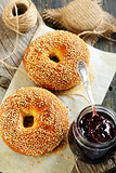 Bagels and jam in a jar.