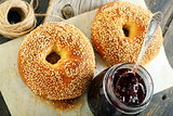 Homemade bagels and lingonberry jam closeup.