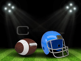 Football ball and helmet in the middle of field