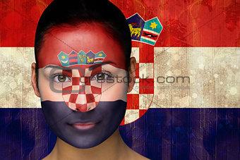 Beautiful football fan in face paint
