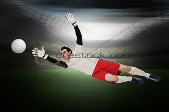Goalkeeper in white making a save