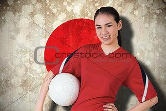 Smiling asian football fan looking at camera