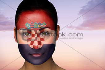 Beautiful brunette in croatia facepaint