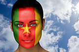 Beautiful brunette in cameroon facepaint