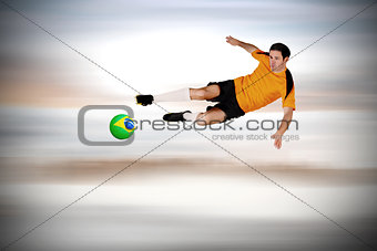 Football player in orange jumping
