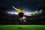 Football player in yellow kicking