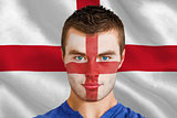 Serious young england fan with facepaint