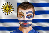 Serious young uruguay fan with facepaint