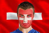 Serious young swiss fan with facepaint