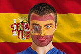 Serious young spain fan with facepaint