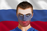 Serious young russia fan with facepaint