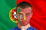 Serious young portugal fan with facepaint