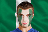 Serious young nigeria fan with facepaint