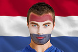 Serious young netherlands fan with facepaint