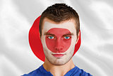 Serious young japan fan with facepaint
