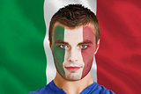 Serious young italy fan with facepaint