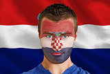 Serious young croatia fan with facepaint