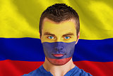 Serious young colombia fan with facepaint