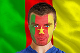 Serious young cameroon fan with facepaint