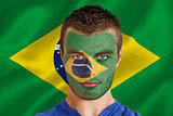 Serious young brasil fan with facepaint