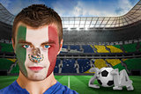 Serious young mexico fan with face paint