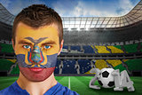 Serious young ecuador fan with face paint