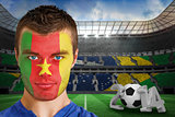 Serious young cameroon fan with face paint