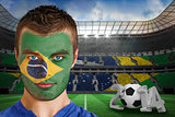 Serious young brasil fan with face paint
