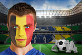 Serious young belgium fan with face paint