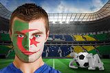 Serious young algeria fan with face paint