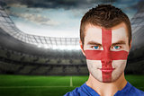 Serious young england fan with face paint