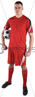 Fit football player holding the ball