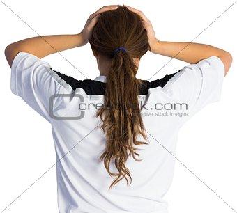 Football fan with hands on head