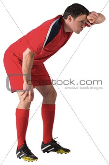 Tired football player bending over