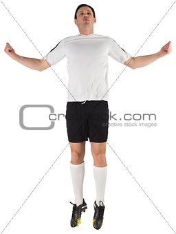 Football player in white jumping
