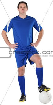 Football player in blue looking at camera