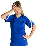Disappointed football fan in blue jersey