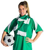Pretty football fan in green jersey