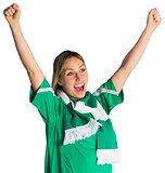 Cheering football fan in green jersey