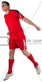 Fit football player jumping up
