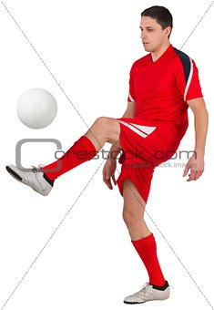 Fit young football player kicking