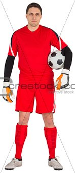 Fit goal keeper looking at camera