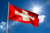Swiss national flag on flagpole