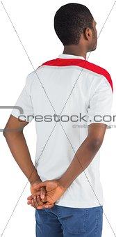 Football fan in white standing