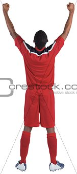 Football player in red cheering