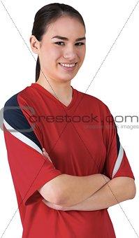Asian football fan smiling at camera