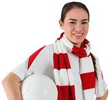 Smiling football fan in white holding ball
